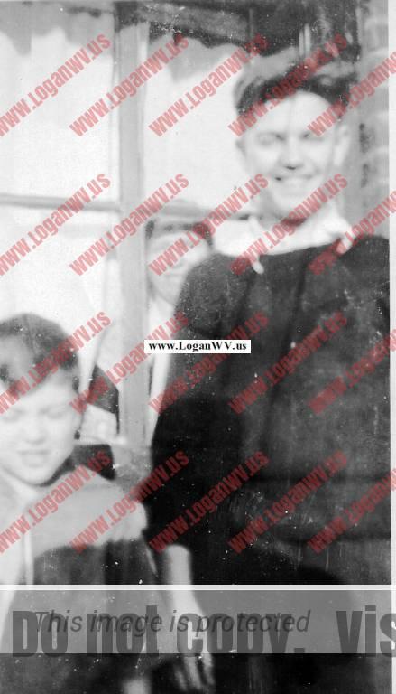 Alex Nagy Sr, Alex Nagy Jr and Julia Nagy in window 1930