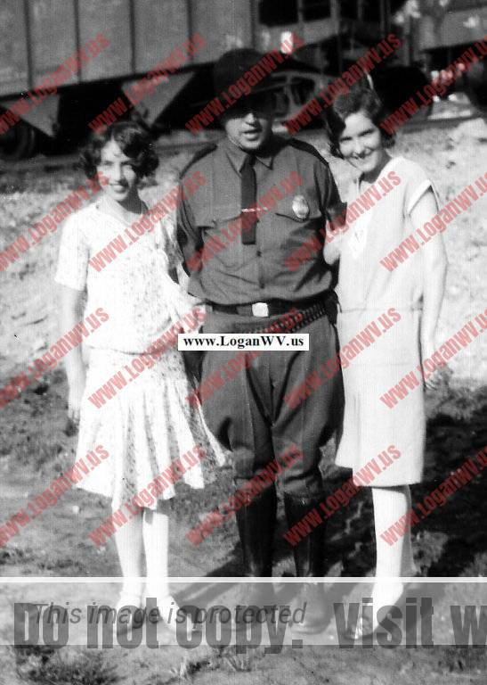 lizabeth Taylor, Ed Taylor & Ethel Taylor.  Ed is in his deputy sheriff unifrom. Taken at Monitor, WV in 1927.