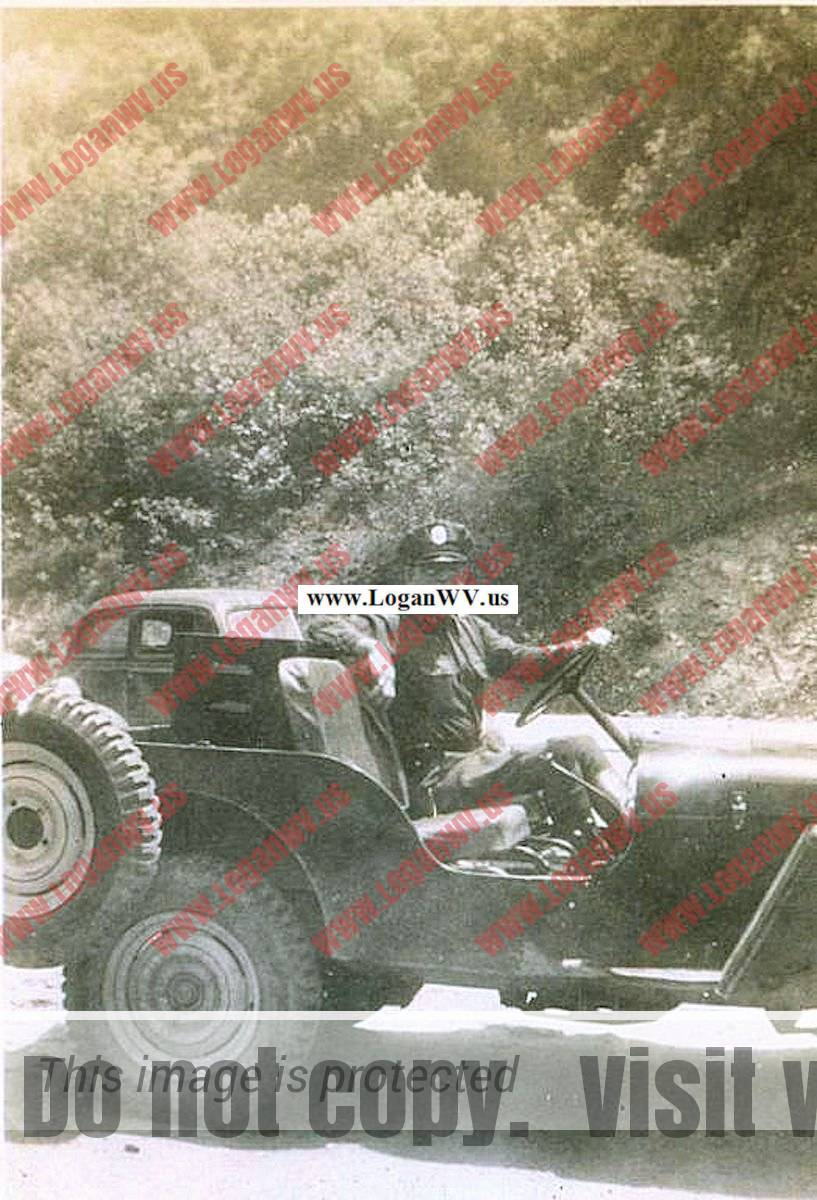 Ira Carper - Game Warden. 1945 Jeep was purchased by Logan County Sportsman Club.