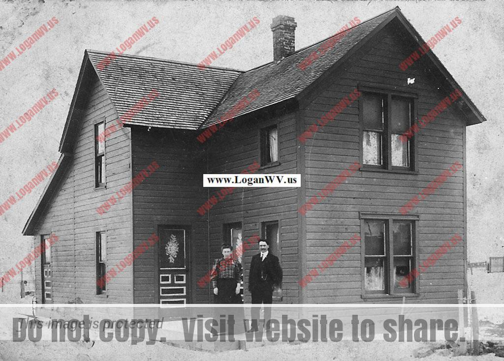 Lizzie Bowling Thomas and husband Heston Thomas of Macelona, MI in front of their new home in 1923.
