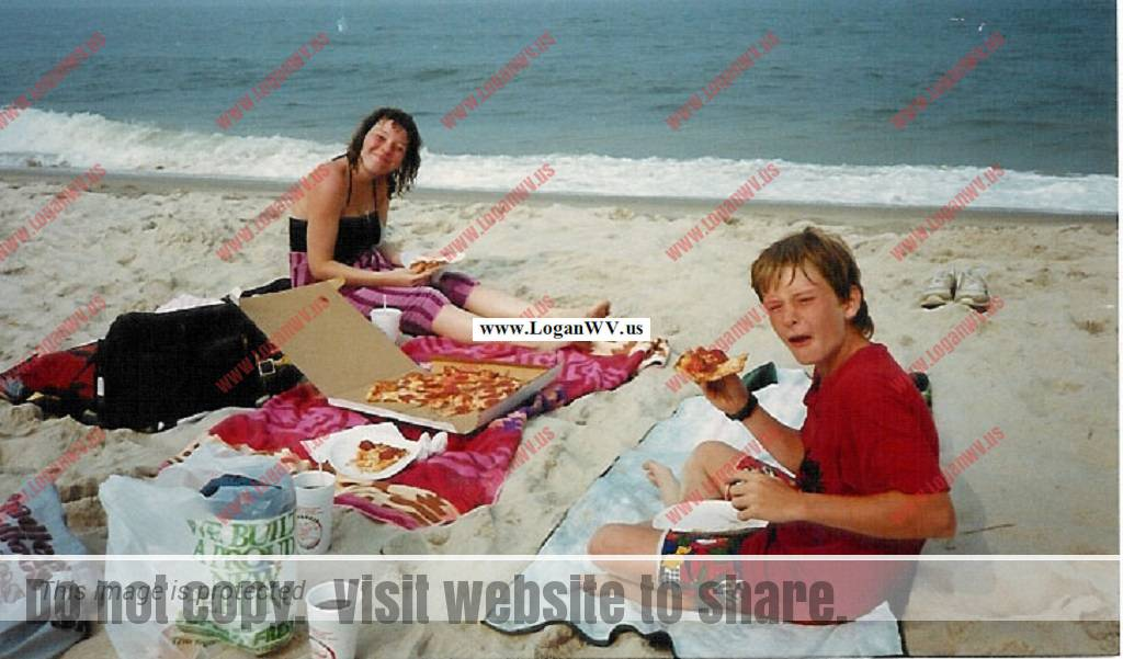 MIchelle McCormack and Robb McCormack at Rehoboth Beach, DE having pizza for lunch.