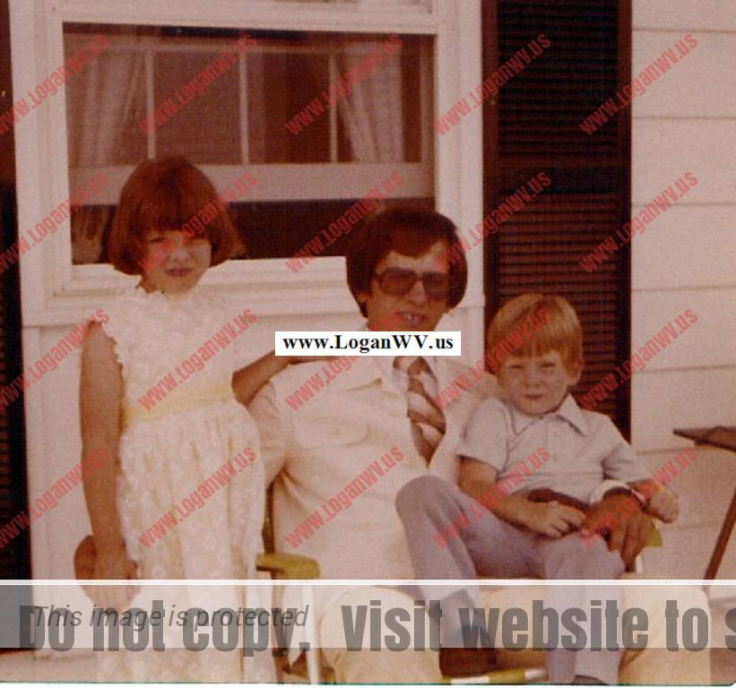 Michelle McCormack, Robert McCormack holding Robb McCormack on the front porch of their home at Mt. Airy, MD.