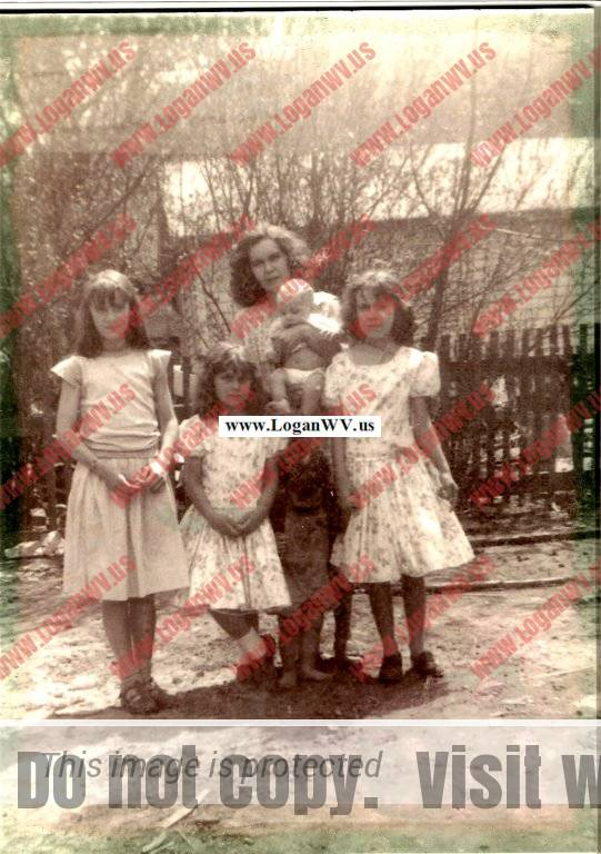 Phyllis, Roger, Elsie, Marie Dyer with Mrs. Dyer holding David 1955