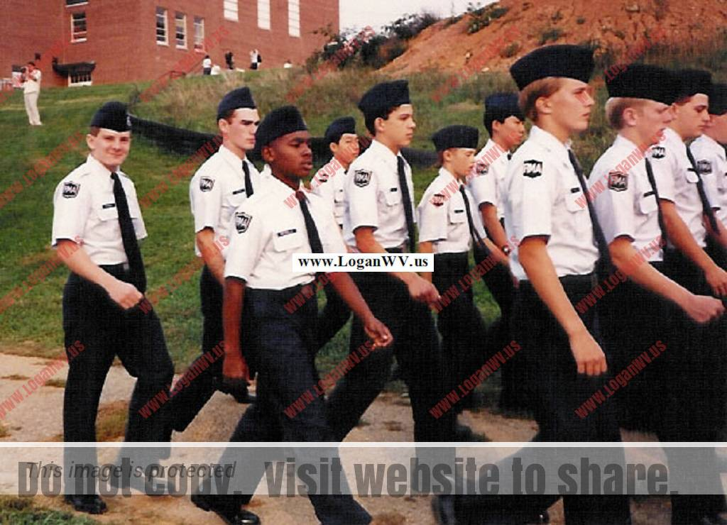 Robb McCormack marching at Randolph Military Academy glancing at his Dad instead of looking straight ahead.