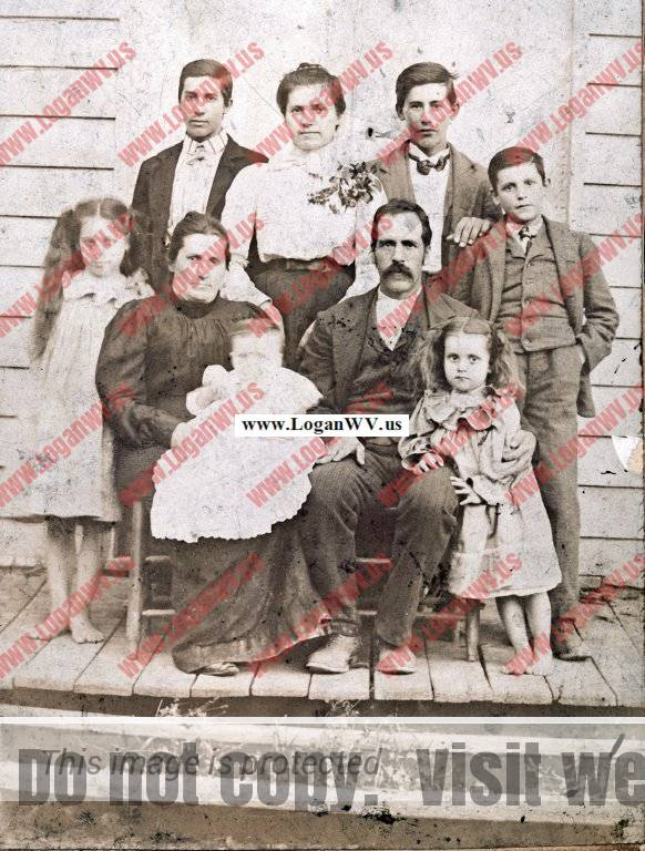 About 1908 Sam McCormack Family of Straight Creek, Carter, County, KY, Back: Alson McCormack, Emma McCormack, Oscar McCormack  Front: Lula McCormack, Sarah McCormack holding Clovis McCormack, Sam McCormack holding Emma McCormack and John McCormack.