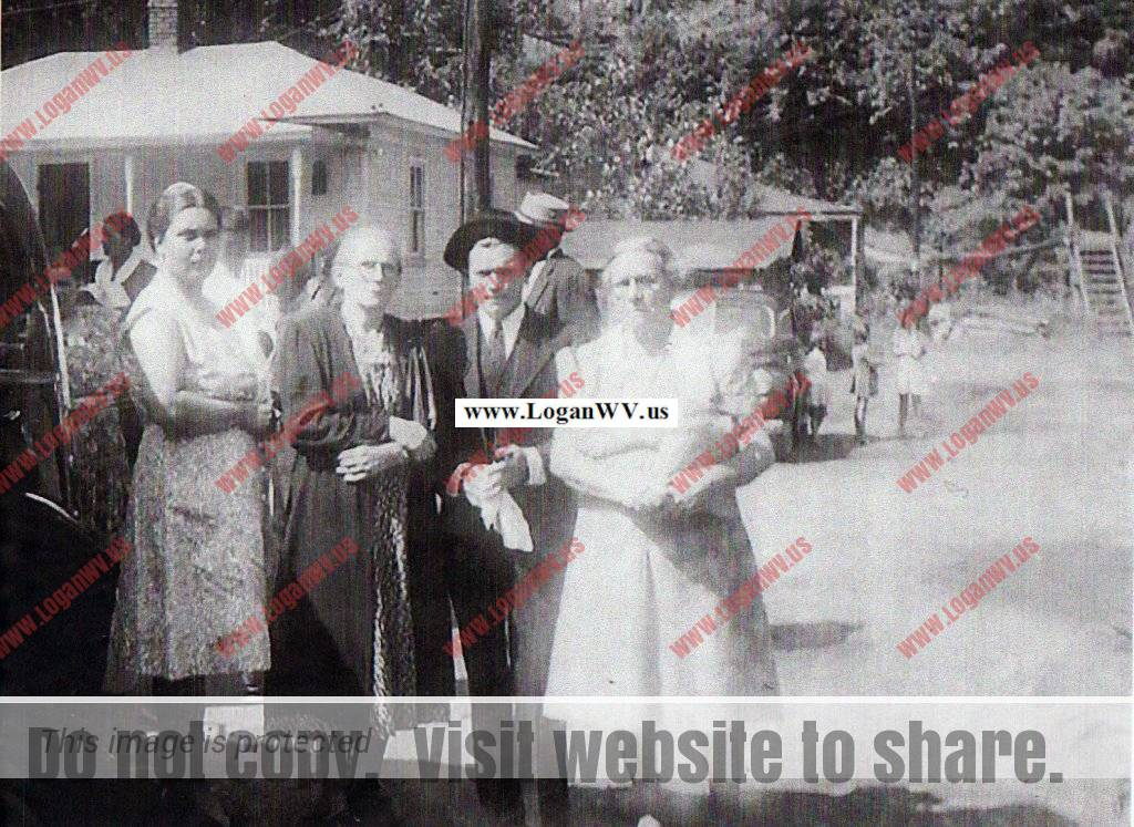 Guy Gore Swinging Bridge  - Maybe Mrs. Corns (Salvation Army) with neighbors.