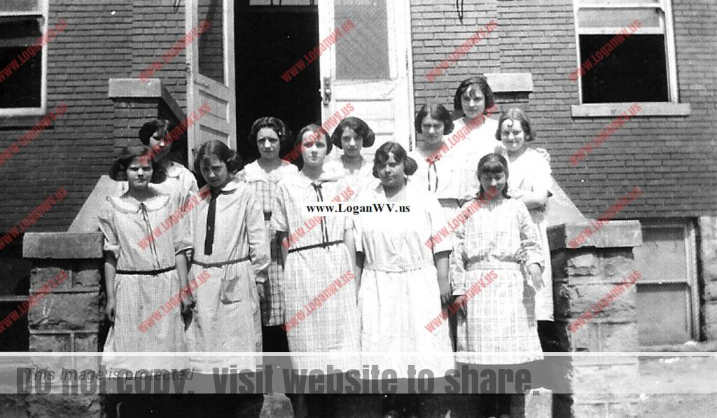 Virginia Taylor and Sewing Class at Logan Junior High School, Logan,WV taken in 1923.  Virginia is front far left..