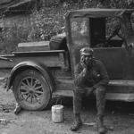 Coal miner waiting to go home in friend's truck. Caples, WV Sept. 1938.