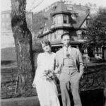 Unknown couple standing in front of the Hinchman Home.
