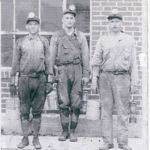 Miners in front of the lamp house at Dehue, Samuel Blevins, Arnold ?, Wesley Cladwell. Courtesy of Lillian Porter-Smith