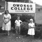 Bob McCormack, Betty, Gregg and Gwen Bailey on campus of Owosso College in Michigan.
