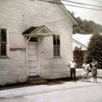 Pilgrim Holiness Church with Ray Smith in front of the church.