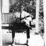 Clyde Taylor on porch of Scott Taylor home at Monitor - July 1924