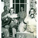 David Ryan playing guitar during WWII with his marine buddies.