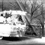 PARADE FLOAT CROSSING THE WATER STREET BRIDGE IN THE LATE 1930's
