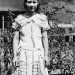 Virginia Taylor in front yard