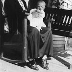 Alice Taylor with grandson, Ronald McCormick taken about 1933 on her front porch at Monitor, WV a few months before her death.