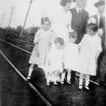 Alonzo and Minnie Bowling with daughters. Taken in front of train station at Hitchens, KY