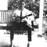 Alonzo Clyde Taylor strumin' on the front porch of his parents, Scott and Alice Taylor.