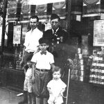 Alonzo Clyde Taylor in military uniform with nephews George, Louis and Billy Taylor (sons of Bijah Taylor).