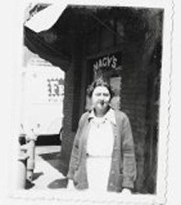 Anna Kiraly - Cashier at Nagy's Grocery