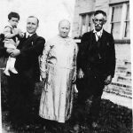 Bijah Taylor holding Louie, his mother,  Alice Taylor and her father, William Bowling, taken at the home of Alonzo Bowling at Hitchens, KY  about 1927.  Four generations represented.
