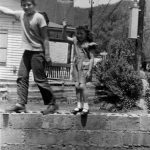 Bobby McCormack with cousin Gwen Brooks.  The A E Mays home and the church in the background.