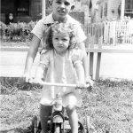 Bobby McCormack with cousin Gwen Brooks.  The Rev Hattie Hickman and Oscar Sansom homes in the background.