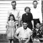 Clovis McCormack and Lee Keathley Families.  Taken in the back yard of Clovis and Virginia McCoramack at Cherry Tree, WV.  Back: Lee Jess Keathley, Virginia McCormack, Clovis McCormack; Front Gwendolyn Joyce Brooks, Ronnie McCormick, Bobby McCormack holding his cat, Topsy.