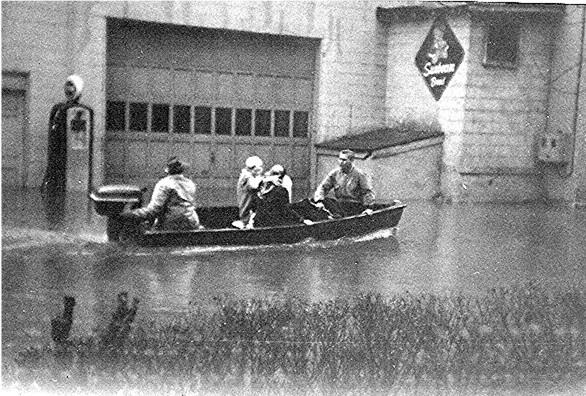 Flood 1957 - Rev Hattie Hickman & Emma Jean being rescued. Sunbeam Bakery in background