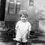George Taylor, son of Bijah Taylor.   Taken in the yard of their home in Chicago.