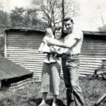 Elyeen  Rhodes holding Vicky Chambers and James Owsley