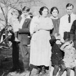 Howard Steele holding daughter Shirley, Crilda Adkins Steele, Lula Adkins Taylor, Jess Taylor, Virginia Taylor, Bob and Ray Wendell in front.  Taken at Monitor, WV.