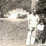 Joe Piros Sr, Helen Piros and Joe Piros Jr. with Esso Station in the background.