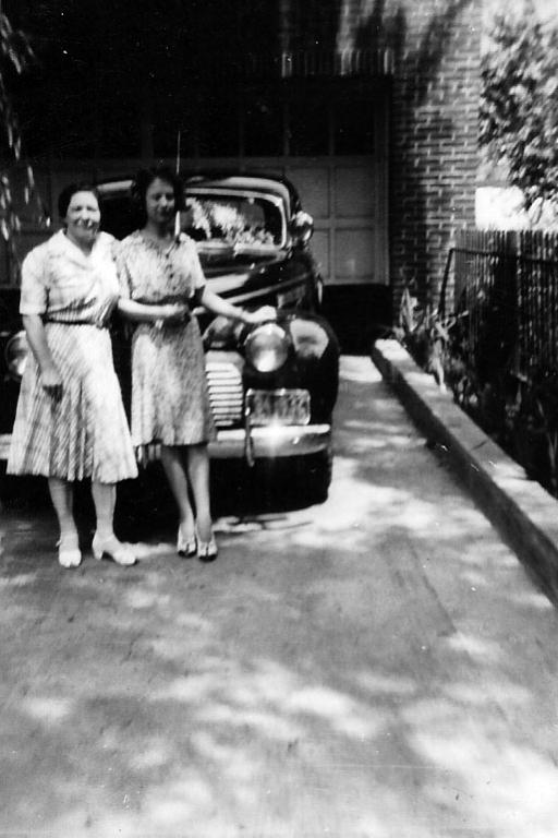 Doris Nagy with Julia Nagy - Julia on left Taken in driveway of the garage apartment.