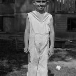 Louis Taylor, son of Bijah and Elizabeth Taylor of Chicago.  Teken in the yard of their home.