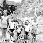 Ray Wendell, Louis Taylor, Mildred Taylor, Paul Taylor, , Bob Wendell --cousins. Taken at a swimming hole at Gilbert, WV.