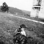 Louis Taylor with dog at the home of his great, Uncle Alonzo Bowling, at Hitchens, KY.