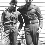 Robert McCormack  in his scout uniform and Ronald McCormick in his Army uniform taken in their backyard at Cherry Tree, WV while Ronnie was home on leave.