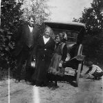 Scott Taylor, Alice Taylor and Elizabeth Taylor during a trip to KY in 1921.  It may be Ed Taylor fixing the flat tire.