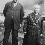 Scott Taylor and Alice Taylor in their yard at Monitor, WV in 1926.