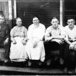 Scott Taylor and Alice Taylor with Neighbors on their front porch at Monitor, WV.  Scott Taylor, Alice Taylor, Beulah Minnick, Sylvestor Jones and unknown.  Beulah drove regularly to church in Cherry Tree and Alice often rode with her.  Alice also read the bible to her since Beulah could not read.