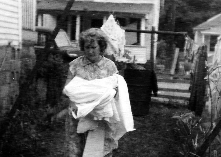 Virginia McCormack in back yard of residence