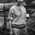 Virginia Taylor taken June 10, 1924 in her front yard at Monitor, WV. Notice the machine building of The Monitor Coal Company in the background.