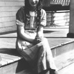 Virginia Taylor on the front porch of her home at Monitor, WV.