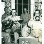 David Ryan playing guitar during WWII with his marine buddies.